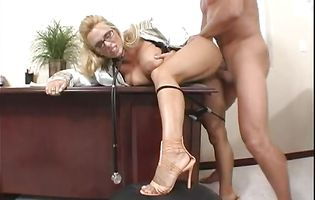 Lusty blonde Holly Halston shows her tits to the camera and gets a pole up her bum
