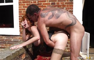 Foxy Tarra White is getting bum banged from the back while standing against the wall